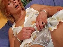 Hairy granny fucks a dildo