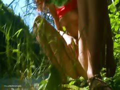 Petite serbian chick peeing in a forest