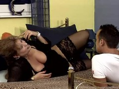Mature floosie Nancy sucks increased by rubs a cock increased by enjoys doggy style banging