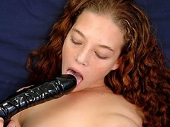 Wait for this horny girl how hard shes poking her tight snatch with her huge black dildo