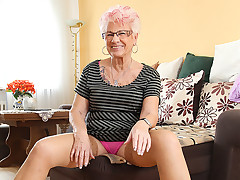 Look at one's disposal this mature whore in pink lingerie looking seductive