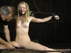 Gagged and fastened nearby looker gets her clits gratified