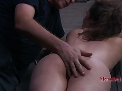 Beauty gets her cunt satisfied whilst inner a cage